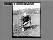 view Football player on field in empty stadium. 10096 photonegative digital asset: Football player on field in empty stadium. 10096 photonegative.