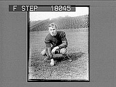 view Football player on field in empty stadium. 10097 photonegative digital asset: Football player on field in empty stadium. 10097 photonegative.