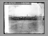view [Low side view of horse race looking toward crowd. Active no. 9917 : non-stereo photonegative.] digital asset: [Low side view of horse race looking toward crowd. Active no. 9917 : non-stereo photonegative.]