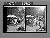 view Queen Alexandra, loving and beloved, rewarding the heroes of the S.A. War Ambulance Corps, Devonshire House. [Active No. 263 : stereoscopic interpositive,] digital asset: Queen Alexandra, loving and beloved, rewarding the heroes of the S.A. War Ambulance Corps, Devonshire House. [Active No. 263 : stereoscopic interpositive,] 1902.