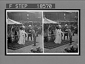 view Queen Alexandra, loving and beloved, rewarding the heroes of the S.A. War Ambulance Corps, Devonshire House. [Active no. 263 : stereo interpositive,] digital asset: Queen Alexandra, loving and beloved, rewarding the heroes of the S.A. War Ambulance Corps, Devonshire House. [Active no. 263 : stereo interpositive,] 1902.