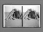 view Navajo blanket weaving--an Indian Hogan (hut) on the Navajo Reservation, Arizona. [Active no. 6168 : stereo interpositive.] digital asset: Navajo blanket weaving--an Indian Hogan (hut) on the Navajo Reservation, Arizona. [Active no. 6168 : stereo interpositive.]