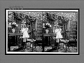 view [Child using table telephone in home.] 6881 interpositive digital asset: [Child using table telephone in home.] 6881 interpositive.