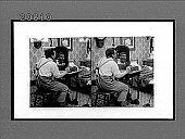 view [Man seated at a table looking at himself in the mirror. Active no. 6999 : interpositive.] digital asset: [Man seated at a table looking at himself in the mirror. Active no. 6999 : interpositive.]