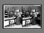view [Man and woman looking at one another; man behind the counter, woman in front of it. Active no. 7117 : Interpositive.] digital asset: [Man and woman looking at one another; man behind the counter, woman in front of it. Active no. 7117 : Interpositive.]