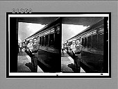 view [Man holding child beside train car.] 7844 interpositive digital asset: [Man holding child beside train car.] 7844 interpositive.