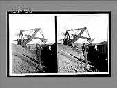 view Giant steam shovels dumping 5-ton load of iron ore into car, open pit iron mine, Hibbing, Minn. 7956 interpositive digital asset: Giant steam shovels dumping 5-ton load of iron ore into car, open pit iron mine, Hibbing, Minn. 7956 interpositive.