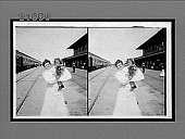 view [Mother holding child outside train station.] 8411 interpositive digital asset: [Mother holding child outside train station.] 8411 interpositive.