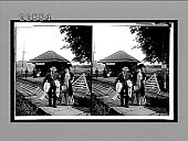 view [Couple with luggage rural leaving train station.] 9413 interpositive digital asset: [Couple with luggage rural leaving train station.] 9413 interpositive.