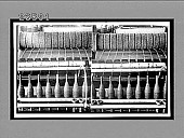 view Close view of spinning machine, showing bobbins full of woolen yarn. 10794 Interpositive digital asset: Close view of spinning machine, showing bobbins full of woolen yarn. 10794 Interpositive 1909.