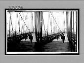 view West down the promenade of Brooklyn Bridge to towering buildings of Manhattan. 11409 Interpositive digital asset: West down the promenade of Brooklyn Bridge to towering buildings of Manhattan. 11409 Interpositive.