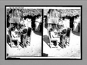 view Shelling beans for dinner in the yard of a humble Colombian home, Barranquilla, S.A. 11513 interpositive digital asset: Shelling beans for dinner in the yard of a humble Colombian home, Barranquilla, S.A. 11513 interpositive 1906.