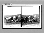 view [Soldiers eating on ground and posing before line of large tents.] [Active no. 11820 : stereo Interpositive.] digital asset: [Soldiers eating on ground and posing before line of large tents.] [Active no. 11820 : stereo Interpositive.]