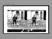 view [Soldier with rifle posing before building with rubble in street.] [Active no. 11821 : stereo Interpositive.] digital asset: [Soldier with rifle posing before building with rubble in street.] [Active no. 11821 : stereo Interpositive.]