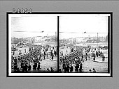 view [Large contingent of soldiers with rifles marching toward bridge over river to city square in background, civilians watching.] Active no. 11825 : stereo Interpositive digital asset: [Large contingent of soldiers with rifles marching toward bridge over river to city square in background, civilians watching.] Active no. 11825 : stereo Interpositive.