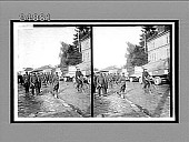 view [Soldiers and bicyclist beside military trucks in village street.] 11883 Interpositive digital asset: [Soldiers and bicyclist beside military trucks in village street.] 11883 Interpositive.