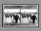 view [Army band group and bicyclist walking in city street.] 11906 Interpositive digital asset: [Army band group and bicyclist walking in city street.] 11906 Interpositive