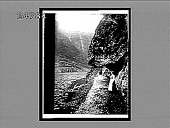 view Where the road creeps under the jutting cliffs by the waters of the Naerofjord. 664 Interpositive digital asset: Where the road creeps under the jutting cliffs by the waters of the Naerofjord. 664 Interpositive 1905.