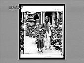 view Indian street musician and child at Hong Kong. 4326 Interpositive digital asset: Indian street musician and child at Hong Kong. 4326 Interpositive.