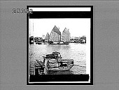 view [Sailboats and smaller boats on wide river in city.] 4354 interpositive digital asset: [Sailboats and smaller boats on wide river in city.] 4354 interpositive.