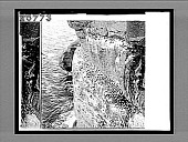 view Gannet ledges, the rugged home of the powerful gannets on the St. Lawrence River, near Perce village. 4780 interpositive digital asset: Gannet ledges, the rugged home of the powerful gannets on the St. Lawrence River, near Perce village. 4780 interpositive.