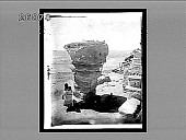 view [Hopi Indian woman with papoose beside odd rock formations.] 6193 Interpositive digital asset: [Hopi Indian woman with papoose beside odd rock formations.] 6193 Interpositive.