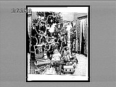 view [Christmas tree and Santa Claus in home living room. Active no. 6886 : black and white non-stereo interpositive.] digital asset: [Christmas tree and Santa Claus in home living room. Active no. 6886 : black and white non-stereo interpositive.]