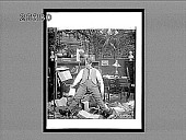 view [Man sprawled in humorous disarray in a Victorian room cluttered with books. Active no. 7074 : non-stereo interpositive.] digital asset: [Man sprawled in humorous disarray in a Victorian room cluttered with books. Active no. 7074 : non-stereo interpositive.]