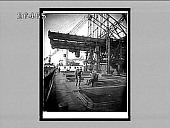 view Unloading an ore steamer, lowering a 5-ton electric clam into the hold, Cleveland, Ohio. [Active no. 7963 : interpositive.] digital asset: Unloading an ore steamer, lowering a 5-ton electric clam into the hold, Cleveland, Ohio. [Active no. 7963 : interpositive.]