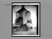 view Towering images of the holy Buddha, symbolizing the serenity of self-renunciation, Pegu. 9024 interpositive digital asset: Towering images of the holy Buddha, symbolizing the serenity of self-renunciation, Pegu. 9024 interpositive.