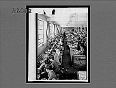 view Stitching shoes in a busy factory--a growing industry--Nuremberg, Germany. 10442 interpositive digital asset: Stitching shoes in a busy factory--a growing industry--Nuremberg, Germany. 10442 interpositive.