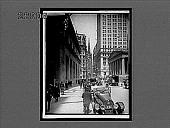 view Wall St., W. past U.S. Sub-Treasury to old Trinity Church, New York. [Active no 10713 : interpositive,] digital asset: Wall St., W. past U.S. Sub-Treasury to old Trinity Church, New York. [Active no 10713 : interpositive,] 1917.