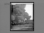 view Fighting huge fire, Standard Oil tanks, Bayonne, New Jersey. 11169 interpositive digital asset: Fighting huge fire, Standard Oil tanks, Bayonne, New Jersey. 11169 interpositive.