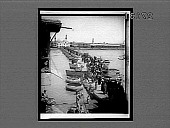 """view Pontoon bridge and odd round boats called """"kufas"""" on the Tigris River, at Bagdad. 11485 interpositive digital asset: Pontoon bridge and odd round boats called """"kufas"""" on the Tigris River, at Bagdad. 11485 interpositive 1912."""