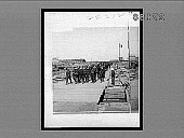 view [Military band marching in dock area. Active no. 22212 : interpositive.] digital asset: [Military band marching in dock area. Active no. 22212 : interpositive.]