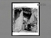 view [American Indian family in front of adobe house in Arizona : Active no. 23303 : Interpositive,] digital asset: [American Indian family in front of adobe house in Arizona : Active no. 23303 : Interpositive,] 1901.