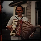 view [Man playing accordion in Madeira Islands : color slide (chromogenic phototransparency).] digital asset: [Man playing accordion in Madeira Islands : color slide (chromogenic phototransparency).]