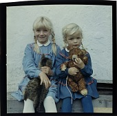 view [Two European girls holding a cat and a teddy bear : color slide (chromogenic phototransparency).] digital asset: [Two European girls holding a cat and a teddy bear : color slide (chromogenic phototransparency).]