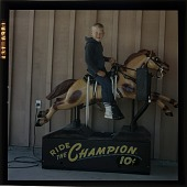 view [Boy on electric horse, Lake Tahoe, Calif. : color slide (chromogenic color phototransparency).] digital asset: [Boy on electric horse, Lake Tahoe, Calif. : color slide (chromogenic color phototransparency).]