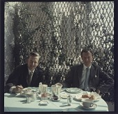view [Composer Benjamin Britten and singer Peter Pears dining at table : color slide (chromogenic phototransparency).] digital asset: [Composer Benjamin Britten and singer Peter Pears dining at table : color slide (chromogenic phototransparency).]