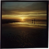 view [Sunset over water with two people standing on shore: color slide (chromogenic phototransparency)] digital asset: [Sunset over water with two people standing on shore: color slide (chromogenic phototransparency)].