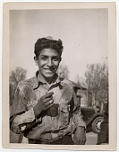 view [Young Gypsy man smiling at the camera, b&w photoprint.] digital asset: [Young Gypsy man smiling at the camera, b&w photoprint.]