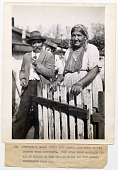 view Gypsytown's oldest couple... [standing at a gate, b&w photoprint.] digital asset: Gypsytown's oldest couple... [standing at a gate, b&w photoprint.]