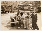 view [Gypsy woman and seven children with Dixie Construction Co. truck, black-and-white photoprint.] digital asset: [Gypsy woman and seven children with Dixie Construction Co. truck, black-and-white photoprint.]