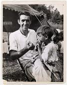 view [Gypsy man lighting a little boy's cigarette, black & white photoprint.] digital asset: [Gypsy man lighting a little boy's cigarette, black & white photoprint.]