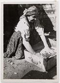 view [Gypsy woman washing clothes in a metal box., b&w photoprint.] digital asset: [Gypsy woman washing clothes in a metal box., b&w photoprint.]