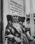 view [Rom Gypsy woman fortune-teller in a booth at a fair, Mineola, Long Island, New York], [photoprint] digital asset: [Rom Gypsy woman fortune-teller in a booth at a fair, Mineola, Long Island, New York], [photoprint].
