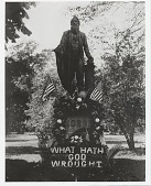 "view [Monument for Samuel Morse with flowers and flags, with sign,""What Hath God Wrought"" : black-and-white photoprint.] digital asset: [Monument for Samuel Morse with flowers and flags, with sign,""What Hath God Wrought"" : black-and-white photoprint.]"