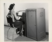 view [Woman seated in front of and typing on a Western Union Telekrypton, black-and-white photoprint] digital asset: [Woman seated in front of and typing on a Western Union Telekrypton, black-and-white photoprint]