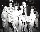 view [Four servicemen carrying Dorothy Lamour and Groucho Marx : black-and-white photoprint.] digital asset: [Four servicemen carrying Dorothy Lamour and Groucho Marx : black-and-white photoprint.]